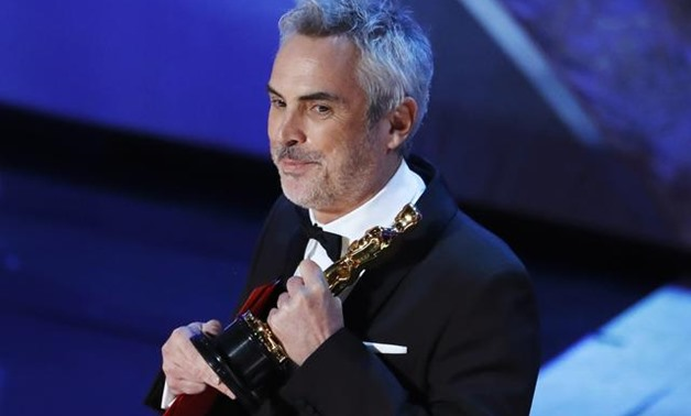 """91st Academy Awards - Oscars Show - Hollywood, Los Angeles, California, U.S., February 24, 2019. Alfonso Cuaron accepts the Foreign Language Film award for """"Roma"""". REUTERS/Mike Blake."""
