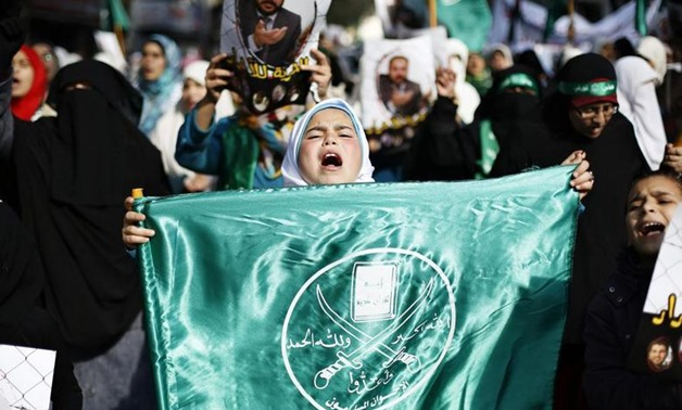 A girl carries a flag of the Muslim Brotherhood as she joins protesters from the Islamic Action Front during demonstration to show their solidarity with Palestinians and anger at a recent political arrest, after the Friday prayer in Amman November 28, 201
