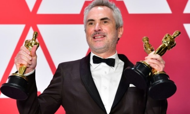 "Mexican filmmaker Alfonso Cuaron is the pride of his homeland after winning three Oscars for ""Roma,"" his ode to his childhood in Mexico City AFP"