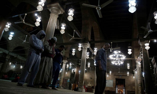 People take part in the night prayers inside an old mosque in Cairo, Egypt December 24, 2017. REUTERS/Amr Abdallah Dalsh