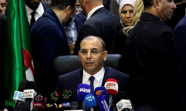 Abdelghani Zaalane, campaign manager of President Abdelaziz Bouteflika speaks after he submitted Bouteflika's official election papers at the Constitutional Council in Algiers
