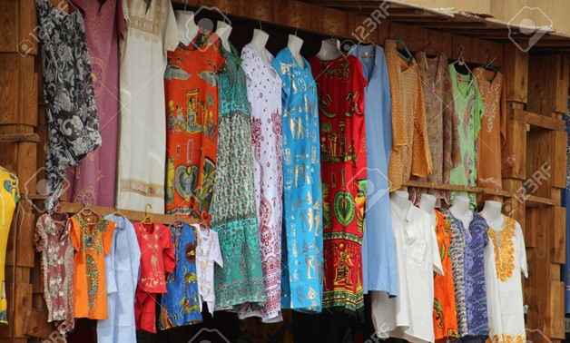 Brightly coloured garments for sale in an Egyptian market - CC