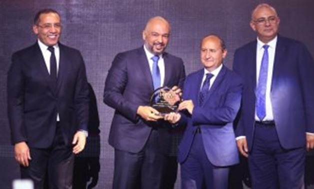 Hazem Metwaly, Chief Executive Officer at Etisalat Misr, Etisalat Misr, receiving the bt100 crystal award