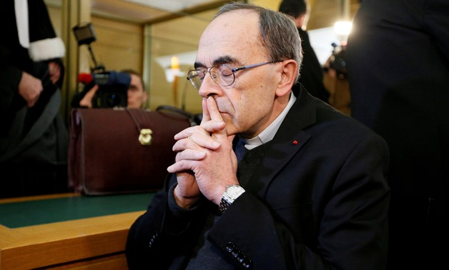 FILE PHOTO: Cardinal Philippe Barbarin, Archbishop of Lyon, arrives to attend his trial, charged with failing to act on historical allegations of sexual abuse of boy scouts by a priest in his diocese, at the courthouse in Lyon, France, January 7, 2019. RE