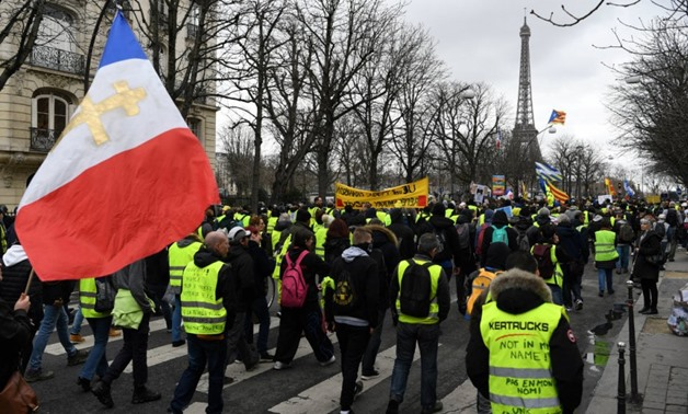 Eric Feferberg, AFP | Protesters take part in an anti-government demonstration called by the Yellow Vest movement, on the Champs-Elysees avenue in Paris, on March 2, 2019.