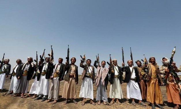 Tribesmen loyal to the Houthi movement hold up their rifles as they shout slogans during a pro-Houthi tribal gathering in a rural area near Sanaa. (File photo: Reuters)