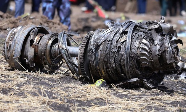 Airplane engine parts are seen at the scene of the Ethiopian Airlines Flight ET 302 plane crash, near the town of Bishoftu, southeast of Addis Ababa, Ethiopia March 11, 2019. REUTERS/Tiksa Negeri