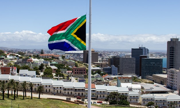 The South African Flag flying on half mast outside the Donkin Reserve in Port Elizabeth during the national mourning period for Nelson Mandela. It is said to be the tallest flagpole in Africa, and the largest South African flag in the world – Wikimedia Co