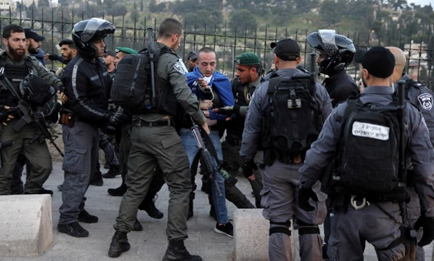 Israeli police officers detain a Palestinian protestor during scuffles outside the compound housing al-Aqsa Mosque in Jerusalem's Old City March 12, 2019. REUTERS/Ammar Awad