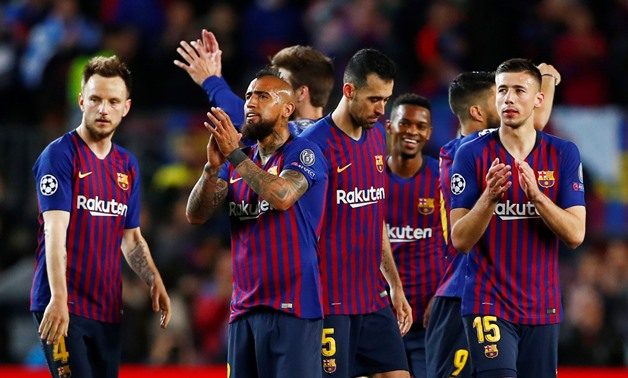 Soccer Football - Champions League - Round of 16 Second Leg - FC Barcelona v Olympique Lyonnais - Camp Nou, Barcelona, Spain - March 13, 2019 Barcelona's Arthur, Ivan Rakitic, Sergio Busquets and Clement Lenglet celebrate after the match REUTERS/Juan Medi