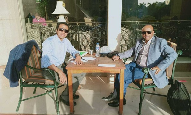 Writer Hassan Ghazaly (L) and IGAD official (R) during interview - Egypt Today