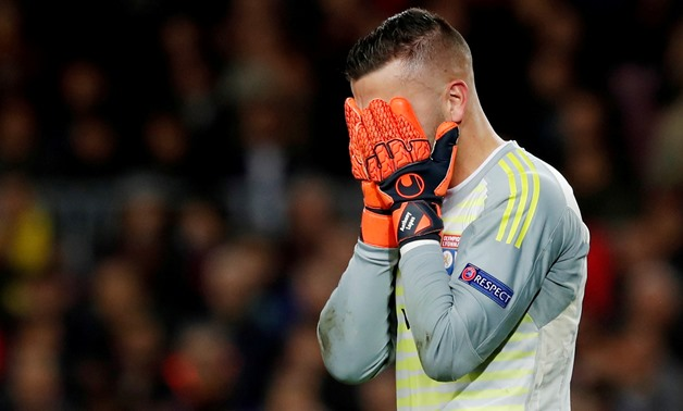 FILE PHOTO: Soccer Football - Champions League - Round of 16 Second Leg - FC Barcelona v Olympique Lyonnais - Camp Nou, Barcelona, Spain - March 13, 2019 Lyon's Anthony Lopes reacts as he is substituted off after sustaining an injury REUTERS/Susana Vera/F