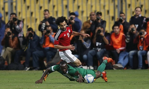 Egypt's Mohamed Salah and Nigeria's Victor Moses in action. REUTERS/Amr Abdallah Dalsh