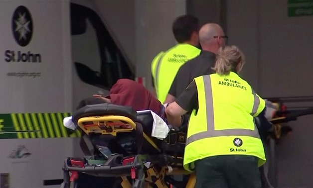 Video grab of emergency services personnel push stretchers carrying a person into a hospital, after reports that several shots had been fired, in central Christchurch