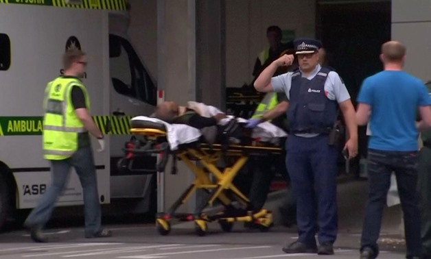mergency services personnel transport a stretcher carrying a person at a hospital, after reports that several shots had been fired, in central Christchurch, New Zealand March 15, 2019, in this still image taken from video- Reuters
