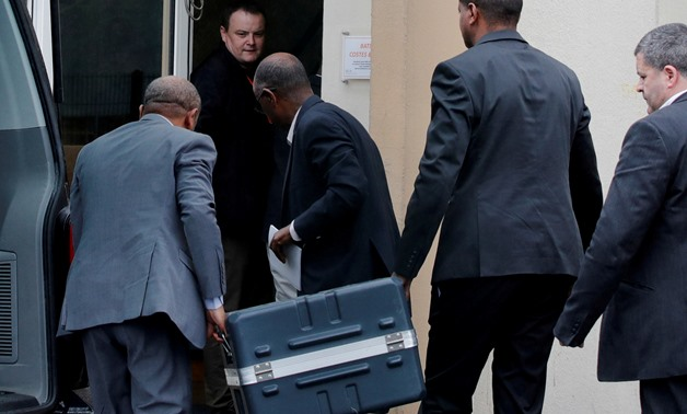 FILE PHOTO: Men unload a case containing the black boxes from the crashed Ethiopian Airlines Boeing 737 MAX 8 outside the headquarters of France's BEA air accident investigation agency in Le Bourget, north of Paris, France, March 14, 2019. REUTERS/Philipp