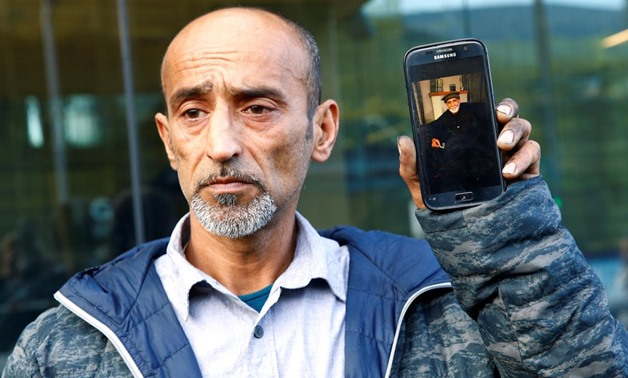 Omar Nabi speaks to the media about losing his father Haji Daoud in the mosque attacks, at the district court in Christchurch, New Zealand, March 16, 2019. REUTERS/Edgar Su