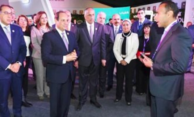 President Abdel Fatah al-Sisi during his visit the Aswan pavilion of the National Bank of Egypt on the sidelines of the Arab-African Youth Platform - Press Photo