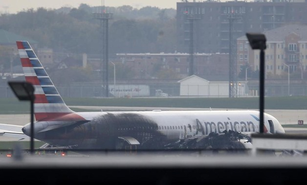 Soot covers the fuselage of an American Airlines jet that blew a tire, sparking a fire and prompting the pilot to abort takeoff before passengers were evacuated from the plane via emergency chute, at O'Hare International Airport in Chicago, Illinois, U.S.