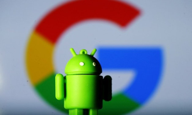A 3D printed Android mascot Bugdroid is seen in front of a Google logo in this illustration. (REUTERS/File)