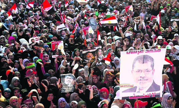 Thousands of former President Mohamed Morsi supporters protesting outside his place of detention in Cairo, July 2013 Photo – Reuters
