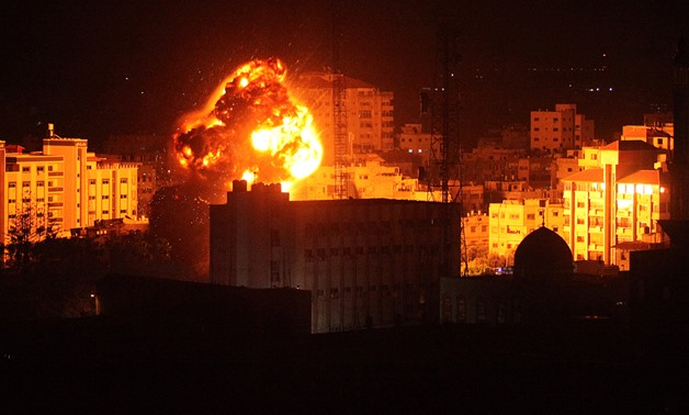 Flame and smoke are seen during an Israeli air strike in Gaza City March 25, 2019. REUTERS/Mohammed Ajour NO RESALES. NO ARCHIVES