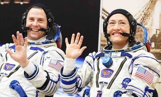 In this file photo taken on March 14, 2019 NASA astronauts Christina Hammock Koch and Nick Hague, members of the International Space Station (ISS) expedition 59/60, react shortly before the launch onboard the Soyuz MS-12 spacecraft from the Russian-leased
