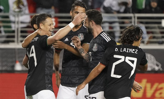 March 26, 2019; Santa Clara, CA, USA; Mexico forward Javier Hernandez (14) is congratulated for scoring a goal against Paraguay during the first half at Levi's Stadium. Mandatory Credit: Kyle Terada-USA TODAY Sports