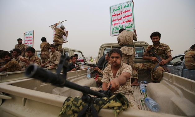 Houthi fighters ride on the back of trucks as they take part in a parade in the Red Sea port city of Hodeidah. By ABDULJABBAR ZEYAD / REUTERS