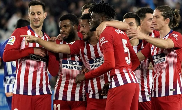 Soccer Football - La Liga Santander - Deportivo Alaves v Atletico Madrid - Estadio Mendizorroza, Vitoria-Gasteiz, Spain - March 30, 2019 Atletico Madrid's Thomas celebrates scoring their fourth goal with team mates REUTERS/Vincent West