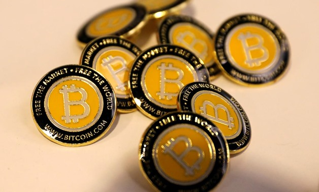 FILE PHOTO: Bitcoin.com buttons are seen displayed on the floor of the Consensus 2018 blockchain technology conference in New York City, New York, U.S., May 16, 2018. REUTERS/Mike Segar/File Photo