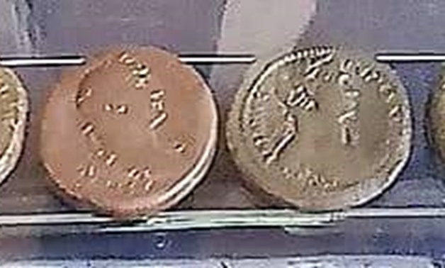 FILE - The Bronze Roman-Era Coins