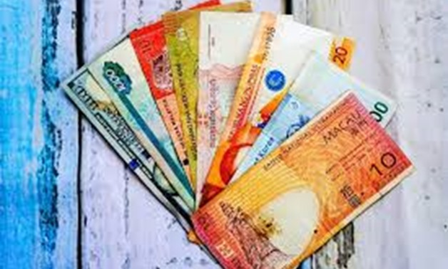FILE- Foreign currencies