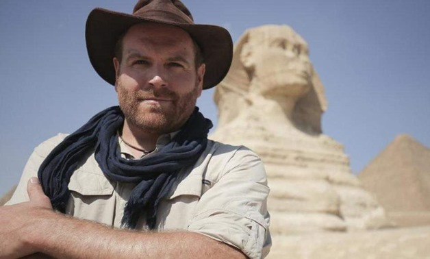 Host Josh Gates in front of the Great Sphinx of Giza in Egypt - Courtesy of Discovery Channel