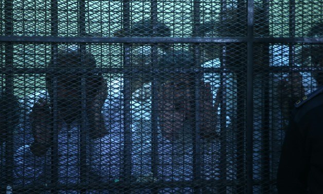 FILE - A number of defendants inside a court's cage - Egypt Today/Ahmed Maarouf