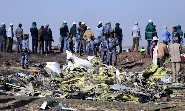FILE PHOTO - Ethiopian Federal policemen stand at the scene of the Ethiopian Airlines Flight ET 302 plane crash, near the town of Bishoftu, southeast of Addis Ababa, Ethiopia March 11, 2019. REUTERS/Tiksa Negeri