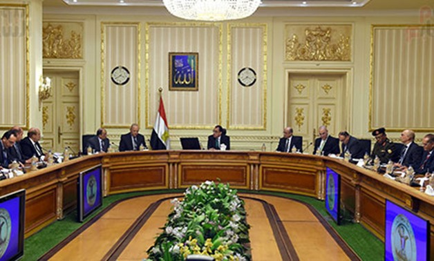 FILE - A meeting for the Egyptian Cabinet