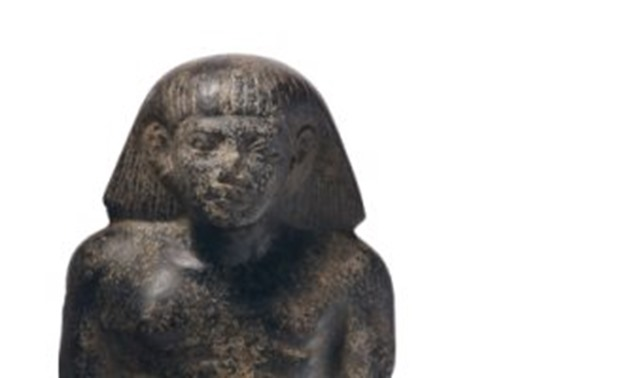 File - Ancient Egyptian basalt statue to be auctioned in        Christie's on April 29.