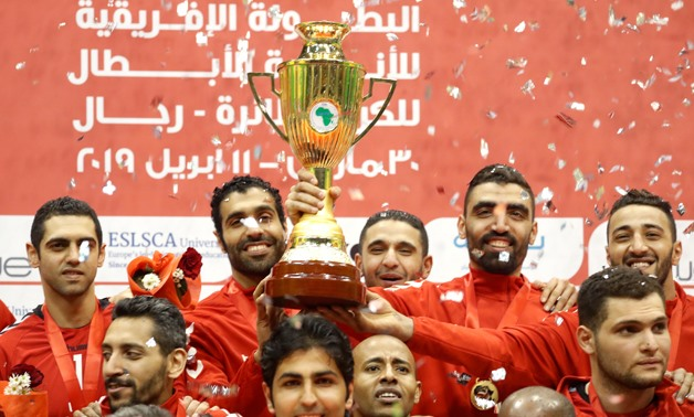 Volleyball - Men's African Volleyball Club Championship - Final - Al Ahly v Smouha - Al Ahly Club Staduim- Cairo, Egypt - April 10, 2019 - Egypt's Al Ahly players celebrate with the trophy after winning the final against Egypt's Smouha. REUTERS/Amr Abdall