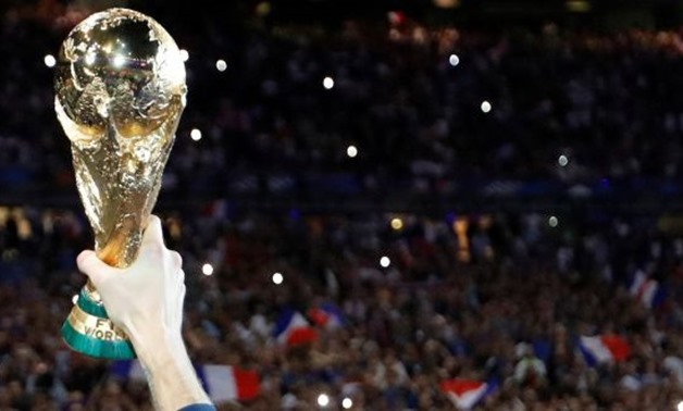 FILE PHOTO: Soccer Football - UEFA Nations League - League A - Group 1 - France v Netherlands - Stade de France, Saint-Denis, France - September 9, 2018 France players celebrates with the World Cup trophy during a ceremony after the match REUTERS/Charles