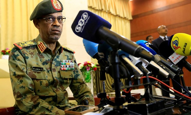 Defence Minister Awad Mohamed Ahmed Ibn Auf, an ex-military intelligence chief talks to the media after being sworn in as first vice president of Sudan - Reuters