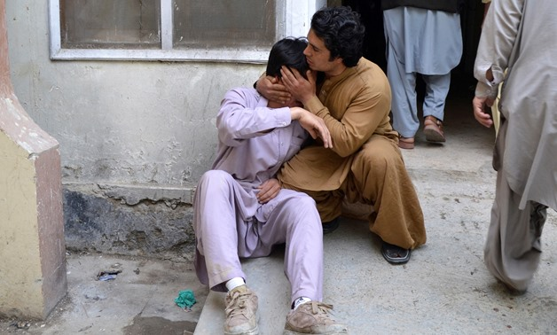Men mourn the death of a relative at a hospital after a blast at a vegetable market in Quetta, Pakistan April 12, 2019. REUTERS/Stringer NO RESALES. NO ARCHIVES.