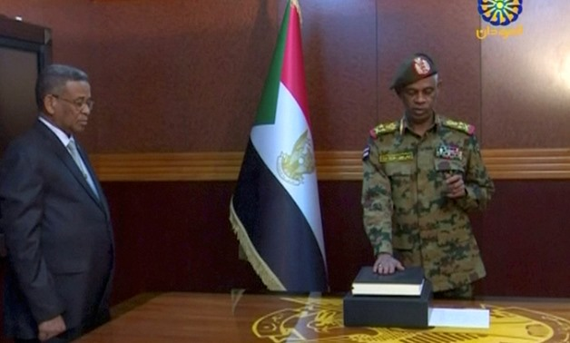 Sudan's Defence Minister Awad Mohamed Ahmed Ibn Auf is sworn in as a head of Military Transitional Council in Sudan in this still image taken from video on April 11, 2019. Sudan TV/ReutersTV via REUTERS