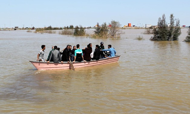 FILE PHOTO: People are seen on a boat after a flooding in Golestan province, Iran, March 24, 2019. Tasnim News Agency/via REUTERS