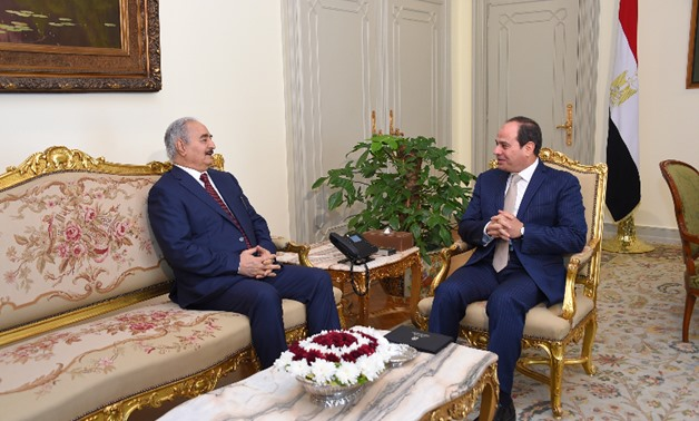 File- President Abdel Fatah al-Sisi (R) meets with Libyan commander Khalifa Hafter in Cairo on May 13, 2017- press photo