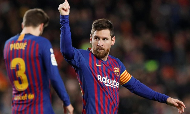 January 13, 2019 Barcelona's Lionel Messi celebrates scoring their second goal with Gerard Pique REUTERS/Albert Gea