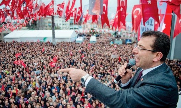 Opposition Republican People's Party (CHP) mayoral candidate, Ekrem Imamoglu, waves to the crowd during a rally in Istanbul on Monday. (AFP)