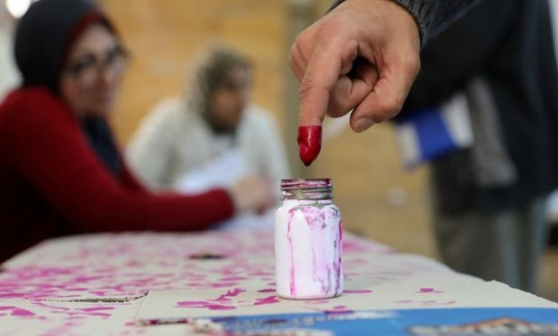 A voter's finger is marked with ink at a polling station during the second day of the presidential election in Alexandria, Egypt March 27, 2018. REUTERS/Mohamed Abd El Ghany