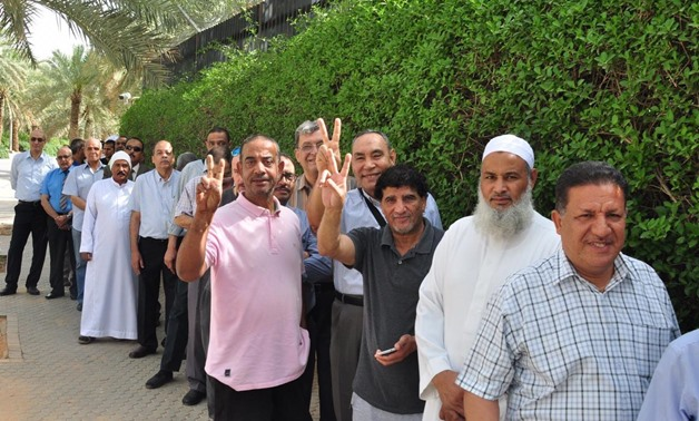 Egyptian expatriates line up in a queue outside the Egyptian embassy in Riyadh to vote  in the public referendum on the new constitutional amendments on Friday- press photo