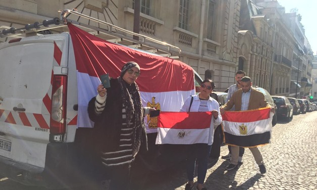Voters in referendum on draft constitutional amendments standing in front of Egypt's embassy in Paris, France. April 19, 2019. Press Photo